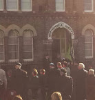 gathering of old soldiers outside old hospital building