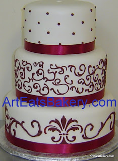 Three tier burgandy apple red and white fondant custom wedding cake with dots, royal icing curlicues and stencils design