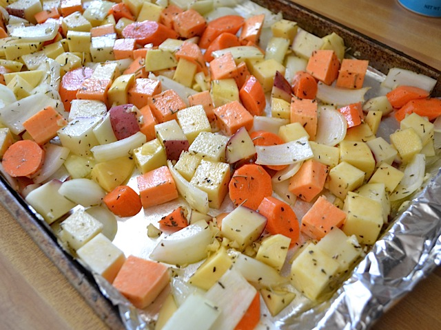 Roasted root vegetables budget bytes use your hands to toss everything to make sure its all coated in oil and the herbs are evenly distributed spread the vegetables out into a single layer on sciox Choice Image
