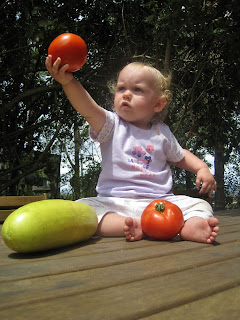 Evie checking out some vegies from the garden