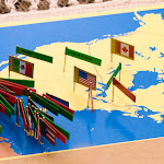 In the Montessori elementary program, children continue their study of political geography. They not only learn the names of countries, but also their flags and capitals, with materials like this Montessori Pinmap of North America.