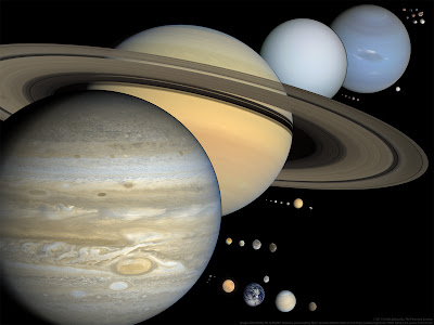 A view of the largest objects in the solar system (other than the Sun), to scale with each other, everything larger than 400 kilometers in diameter, except that there are only eight trans-Neptunian objects standing in for lots that probably are larger than that. Credit: © 2011 Emily Lakdawalla, the Planetary Society. Images from NASA / JPL & JHUAPL missions, processed by Bjorn Jonsson, Mattias Malmer, Ted Stryk, & Gordan Ugarkovic. TNO art by NASA, ESA, and A. Feild (STScI)