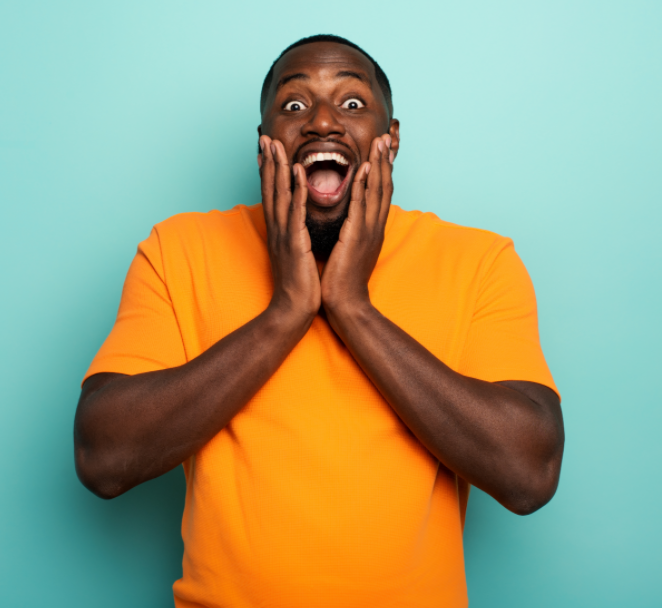 Man with astonished expression with mouth open.