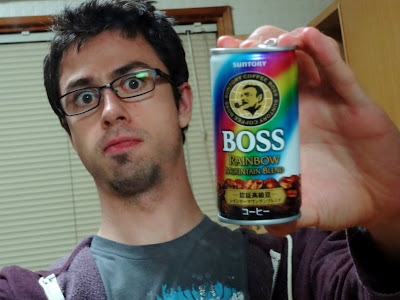 Me making a silly face and displaying a can of Boss coffee