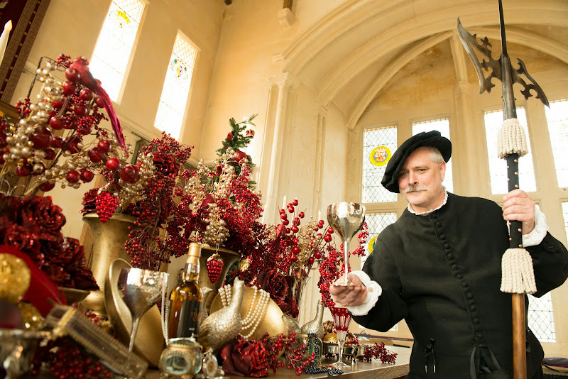 Renaissance costumed character at Stirling Castle toasts the opening of the Clan and Christmas shop