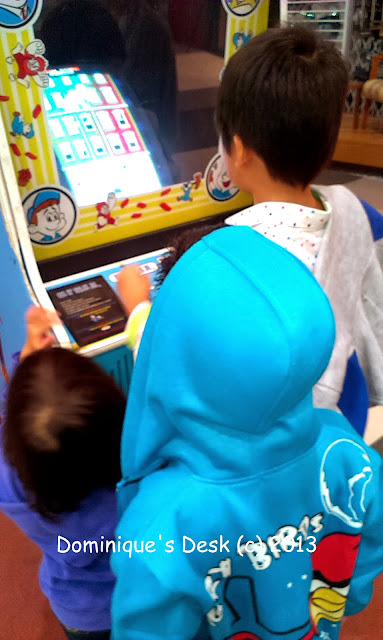 The kids trying out a gaming machine