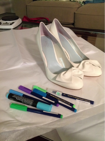 white shoes with bow and fabric markers