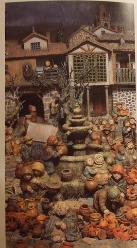 Belen de Baltar: vista de la fuente de la plaza del pueblo donde se congrega la gente junto a un vendedor de vasijas de barro