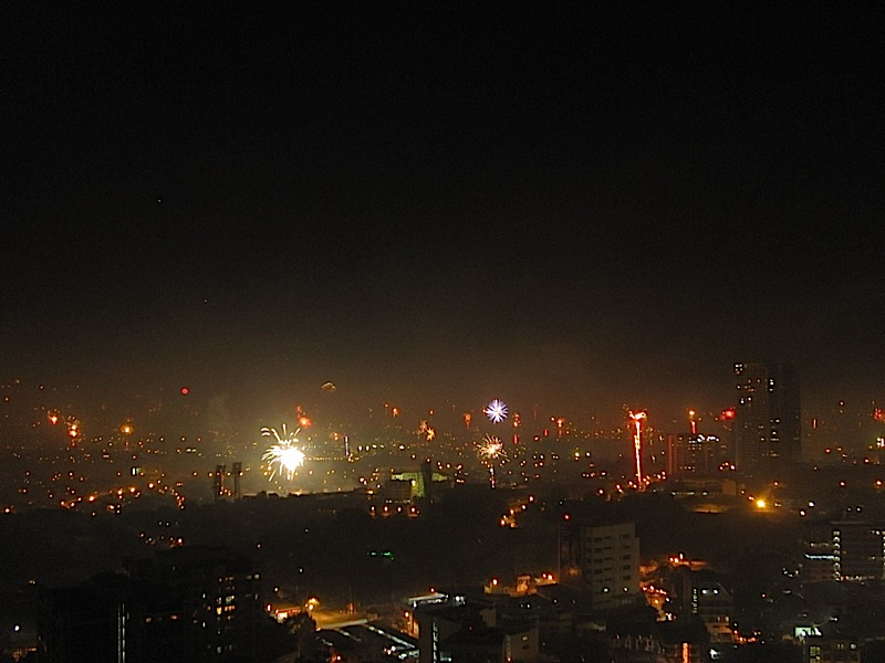 small bursts of fireworks over Pasig City