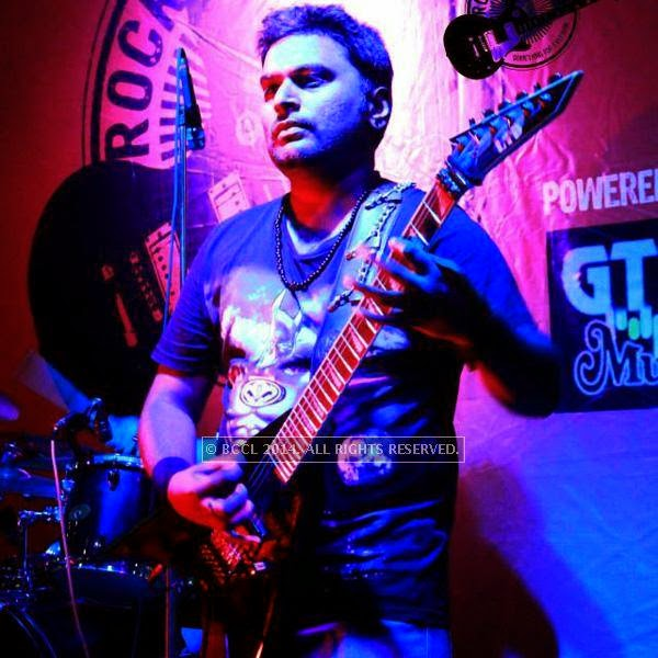 Guitarist and vocalist Ashish Pandey strums a note during the performance of Spikedhead at the weekend show of Rock Studio at R3 mall in Ahmedabad.