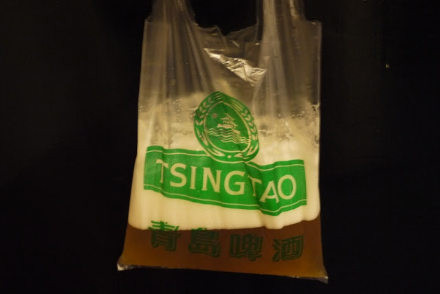 beer in a plastic bag with the Tsingtao logo