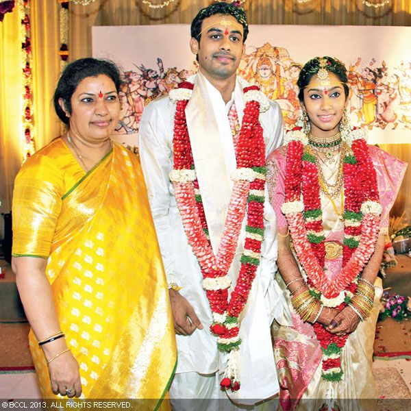 Newlyweds Hitesh and Sri Puja poses with Purandeswari during their wedding ceremony, held in the city recently.