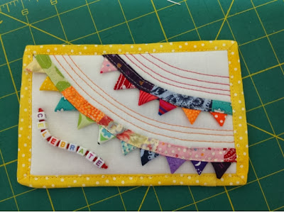 """Celebration"" themed fabric postcard"