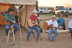Dan Roberts, Red Steagall, and Dick De Guerin perform at the wagon on family night
