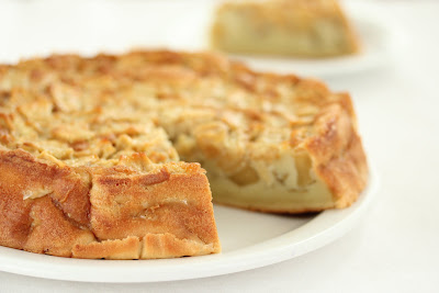 photo of an apple cake with a slice removed