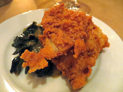 Happiness is an Irving St Kitchen fried chicken with smashed potatoes and country gravy and greens.