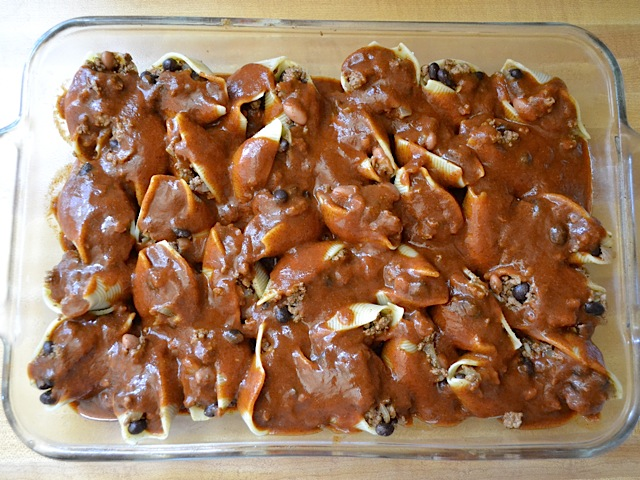 smothered shells ready to bake
