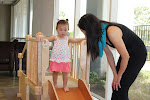 At the LePort Schools Parent & Child Montessori Infant program, moms encourage safety in activity with words. Here, this mom asks her daughter to sit down before sliding down, motivating her child to follow directions, enhance listening skills which supports her independence in decision making.