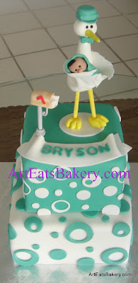 Teal blue dots and circles square two tier fondant modern babyshower cake design with edible stork, baby and mail box topper