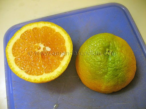 A close up photo of an orange sliced in half.