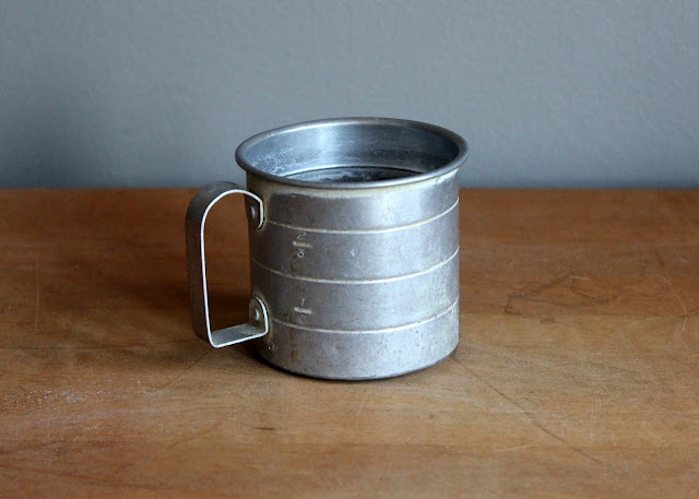 Small tin cup available for rent from www.momentarilyyours.com, $0.75.