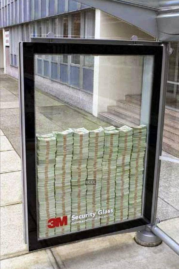 The 3M Company's security glass advertisement showcases dollars inside an unbreakable glass case. Well, what a way for brand promotion!