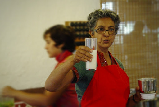 Dr. Nandita holding up a glass of delicious Cashew Nut Milk