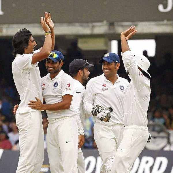India's Ishant Sharma (L) celebrates after taking the wicket of England's Joe Root (not pictured) for 66 runs on the fifth day of the second cricket Test match between England and India at Lord's cricket ground in London, on July 21, 2014.