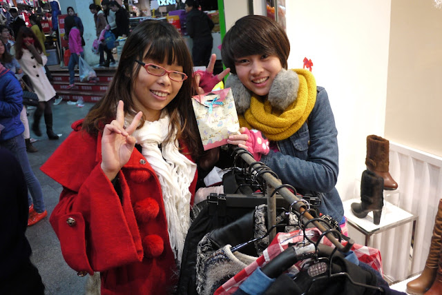 two young woman and a Christmas Eve apple gift in Quanzhou, China