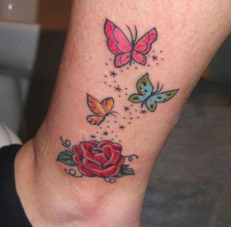 colorful butterfly tattoos with rose flower on leg