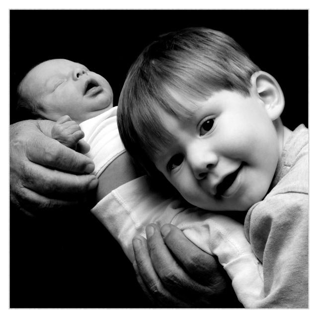 New Born & Toddler in hands