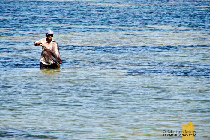 A Fisherman Busy at Work at Bolinao, Pangasinan