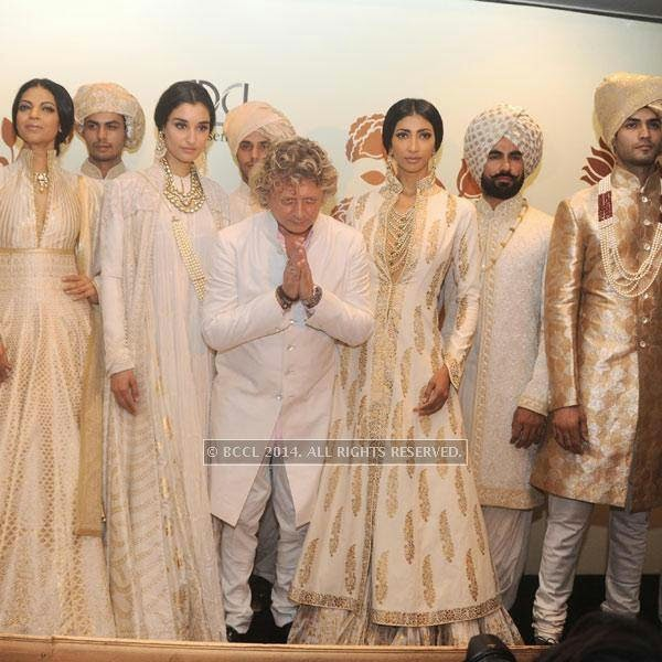 Rohit Bal poses with models Noyonika , Kanishtha and lakshmi Rana on Day 3 of India Couture Week, 2014, held at Taj Palace hotel, New Delhi.