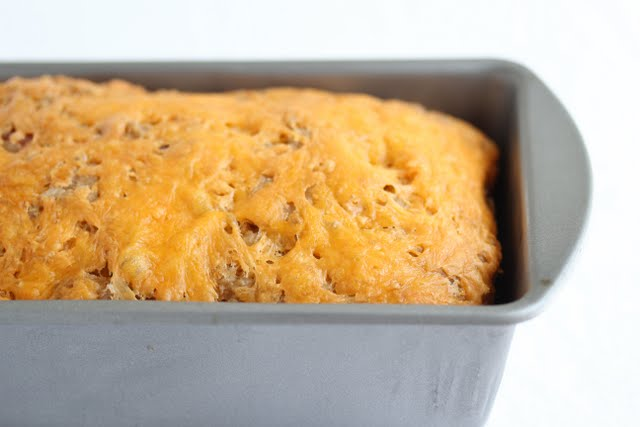 close up photo of beer bread in a loaf pan