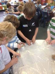Baxter, Lucy and Maz are pressing their fossil imprint into the clay