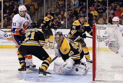 Tuukka Rask makes a save against the Islanders