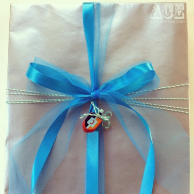 gift with dreidel by Ace Gift Wrapping Service