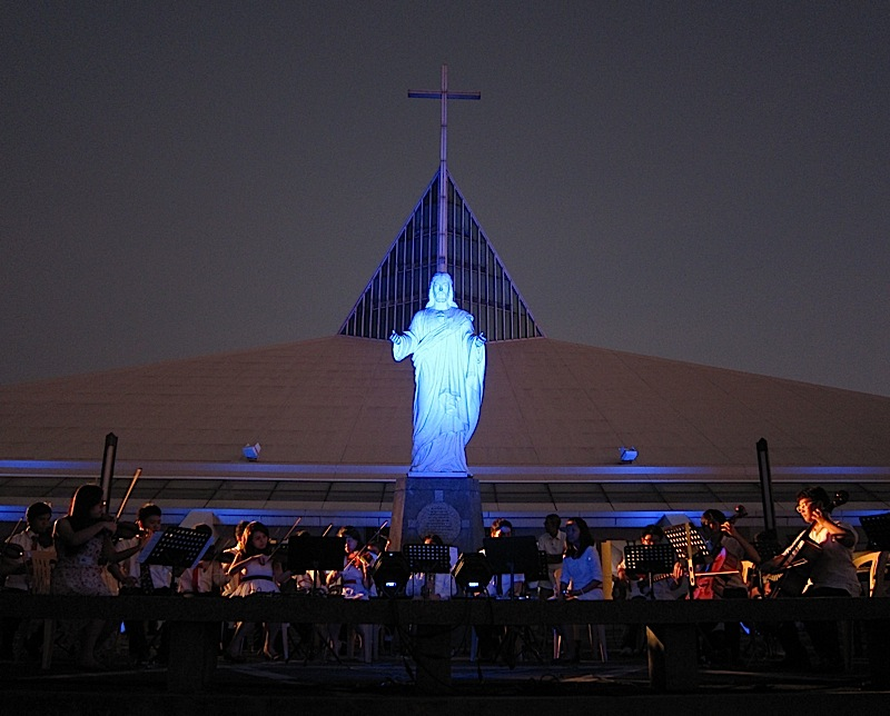 the Blue Symphony performing at the Sacred Heart Plaza of the Ateneo Church of the Gesù