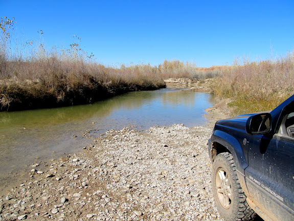 Jeep on the north side of the San Rafael River at Fuller Bottom