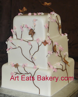 Three tier custom square pink flowers and brown and gold butterflies modern wedding cake design
