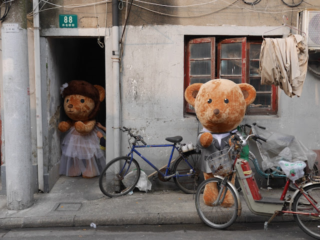 two large stuffed bears dressed up for a marriage