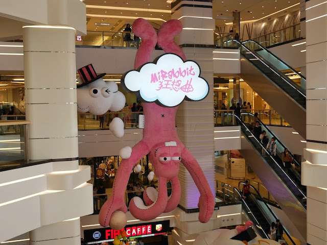 multistoried stuffed pink Mi Rabbit hanging upside down