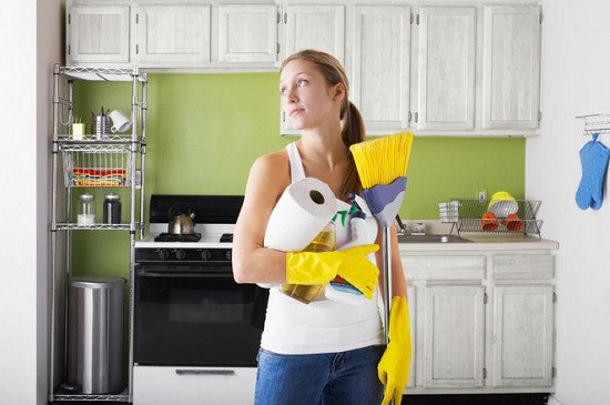 woman-with-cleaning-products-in-kitchen.jpg