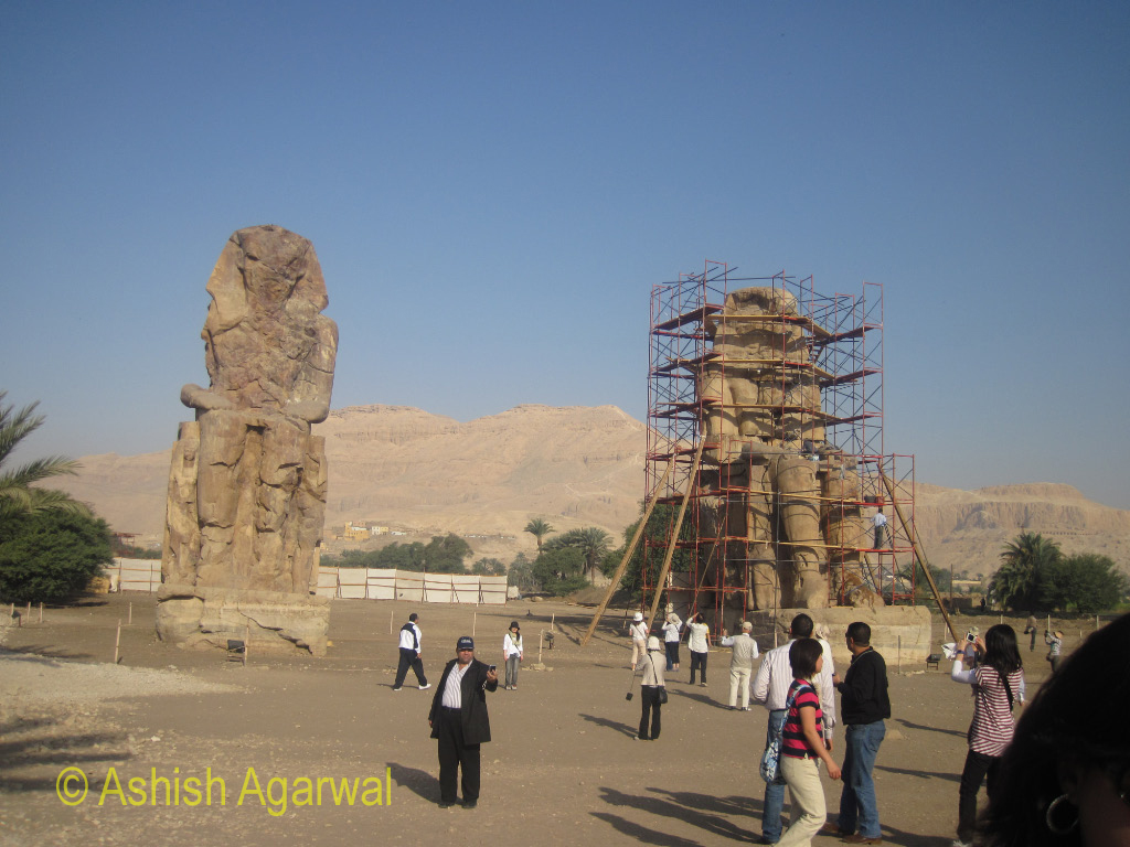 Tourists at the Colossi of Memnon just outside Luxor, in Egypt