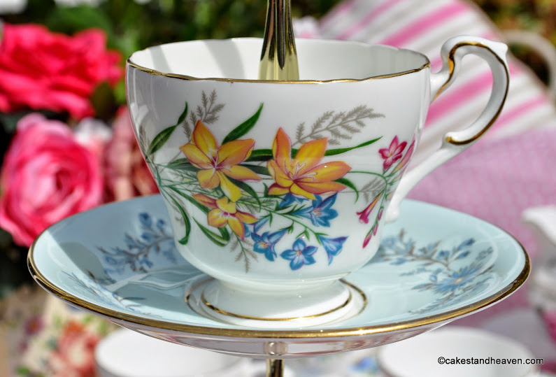 colourful floral vintage teacup and saucer on a cake stand