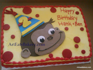 Curious George custom yellow butter cream twin boys birthday cake design with red fondant polka dots