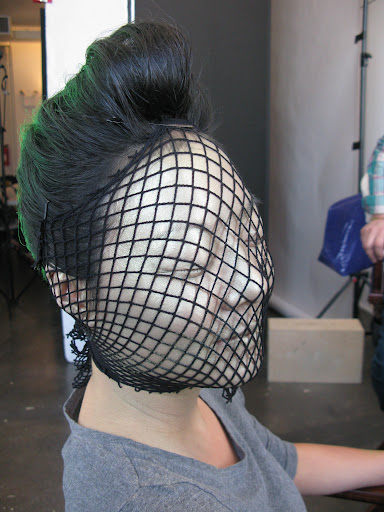 A piece of fishnet stocking was used to stencil scales on Steph's face.