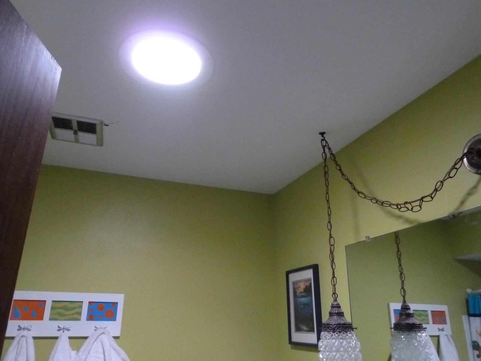 how to bring light into a bathroom with no windows