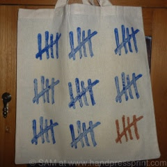lino print tote bag, tally marks, royal blue, bronze