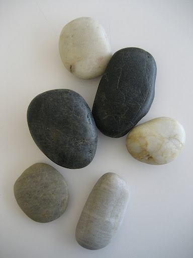 I gathered some smooth rocks which I SHOULD have painted painted the color of the flocking powder. (Learn from my mistake and paint the rock first!)